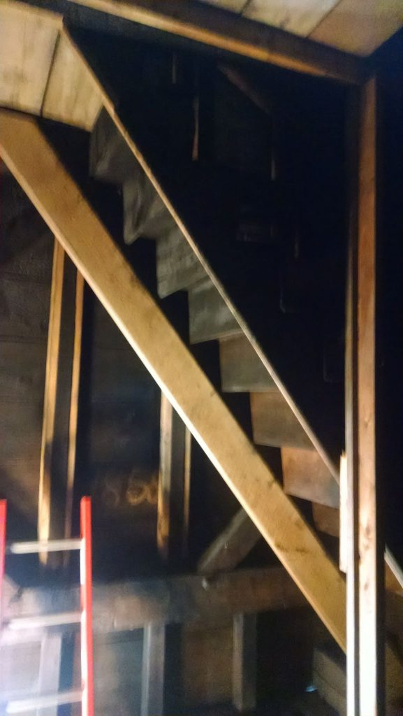 Before we could contemplate hauling the timbers needed for the floor under the belfry, the stair stringer, heavily damaged by a fire years ago, had to be sistered.